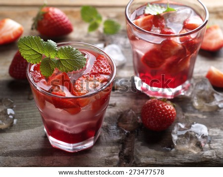 Summer drink with strawberry in glasses on the vintage wooden table, selective focus - stock photo