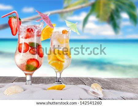 Summer drinks on sunny beach - stock photo