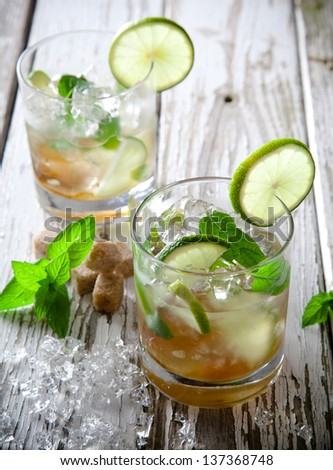 Summer drinks on vintage wooden background - stock photo