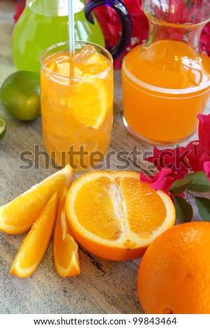 Summer drinks with fresh sliced oranges and limes ready to serve.