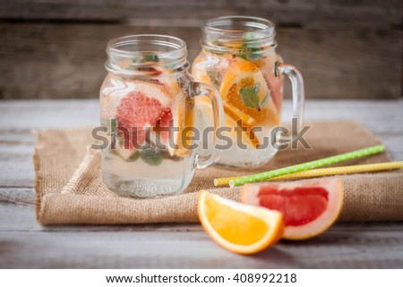 Summer drinks with grapefruit and ice - stock photo