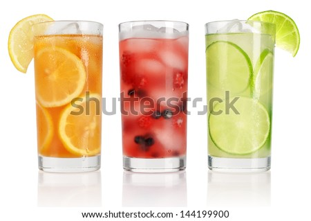 Summer drinks with ice, fresh berries, lemon and lime isolated on white - stock photo