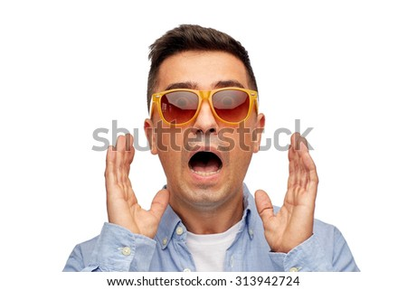 summer, emotions, style and people concept - face of scared middle aged latin man in shirt and sunglasses - stock photo