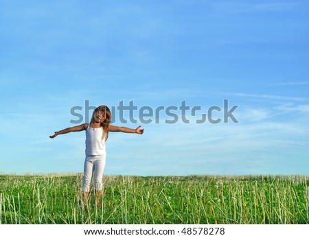 Summer enjoyment, little girl standing with outstretched arms