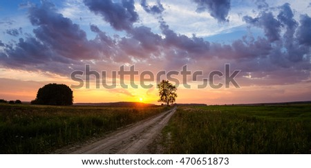 summer evening in a field with a road, Russia, Ural