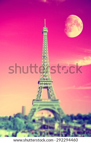 summer evening moon over the Eiffel Tower symbol of Paris. Travel to Europe and France - stock photo