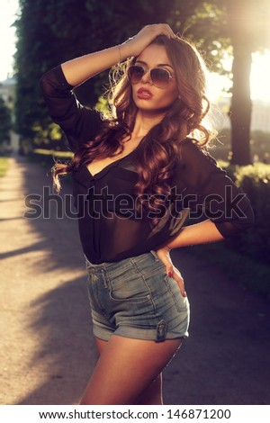 summer fashion portrait of young beautiful stylish girl posing outdoors           - stock photo