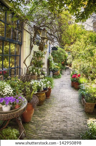 summer flower street in small town - stock photo