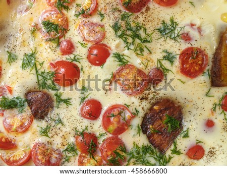 Summer food background - omelette with with cherry tomatoes and aubergine - stock photo