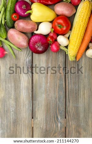 Summer frame with fresh organic vegetables on wooden background - stock photo
