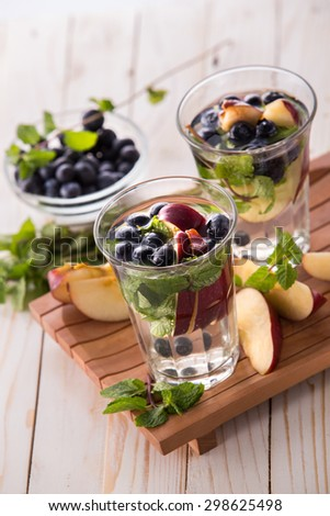 Summer fresh fruit Flavored infused water mix of blueberry, apple and mint - stock photo