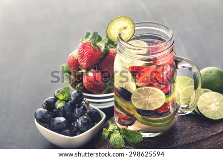 Summer fresh fruit Flavored infused water mix of Strawberry, grape and lime - stock photo