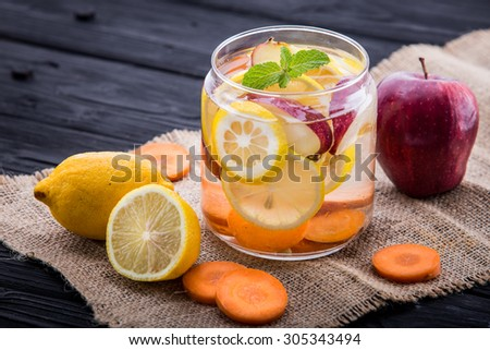 Summer fresh fruit Flavored infused water of apple, lemon, and carrot - stock photo