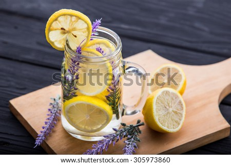 Summer fresh fruit Flavored infused water of lemon and lavender - stock photo