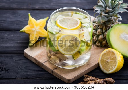 Summer fresh fruit Flavored infused water of starfruit, ginger, and pineapple - stock photo