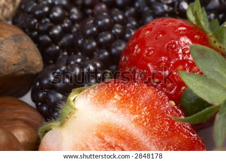 Summer fruit salad ingredients, sliced strawberries and chestnuts