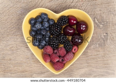 Summer fruits in a bowl - stock photo
