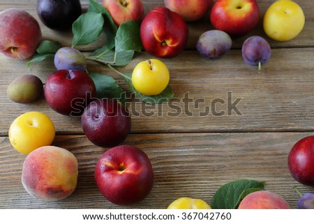 summer fruits on wooden boards, food close-up - stock photo