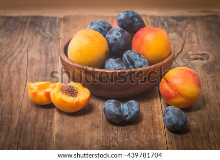 Summer fruits - plums and apricots - stock photo