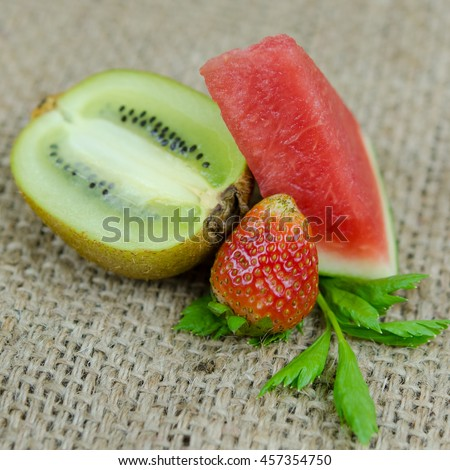 summer fruits: watermelon, strawberries and kiwi - stock photo