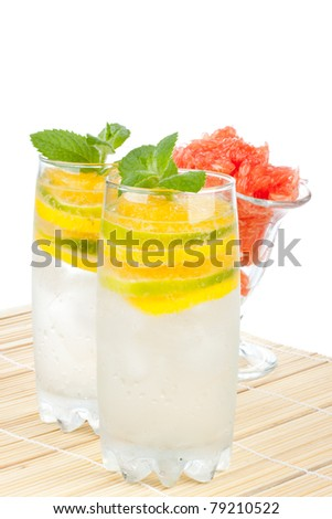 Summer fruity drink with ice on a white background. - stock photo
