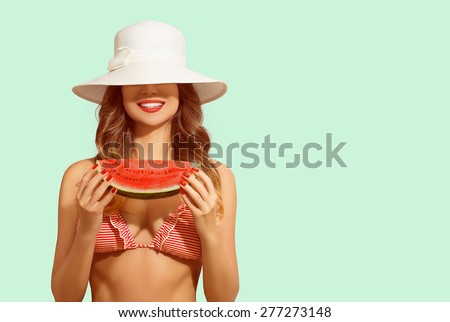 Summer fun, happy woman covers face with hat, holding water melon and smiling. Concept of vacation, healthy eating, diet.  - stock photo