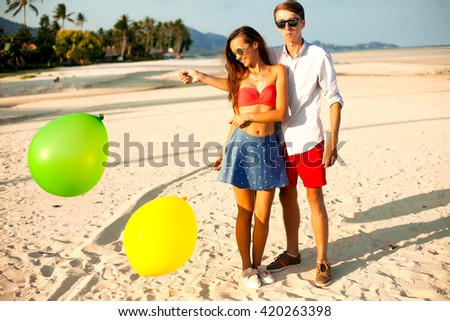 Summer funny couple image,Couple kissing happiness fun. Interracial young couple embracing laughing on date. Caucasian man, Asian woman on tropical island,Thailand,Philippines,Bali beach,samui,fun - stock photo