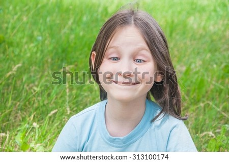 summer funny girl hamming kid on the background of green grass