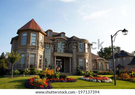 Summer garden house home with copper metal roof and stucco finish.
