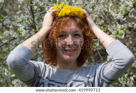 Summer,  garden, laughing girl with a wreath on his head