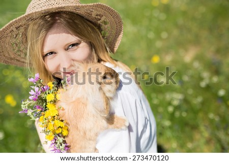 summer girl holding bunny in the nature, selective  - stock photo