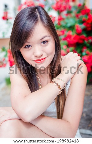 Summer girl portrait. Asian woman smiling.