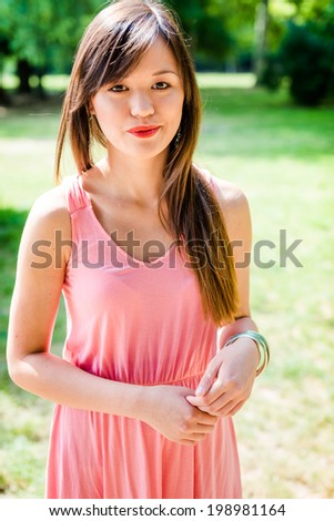 Summer girl portrait. Asian woman smiling happy.