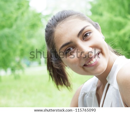 Summer girl portrait. Asian woman smiling happy on sunny summer or spring day outside in park by lake. Pretty mixed race Caucasian / Chinese Asian young woman outdoors. - stock photo