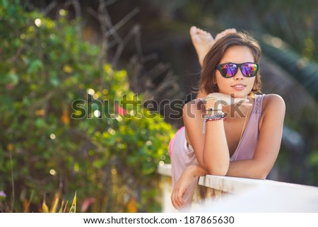 Summer girl portrait. Asian woman smiling happy on sunny summer or spring day outside in park by lake. Pretty mixed race Caucasian young woman outdoors. - stock photo