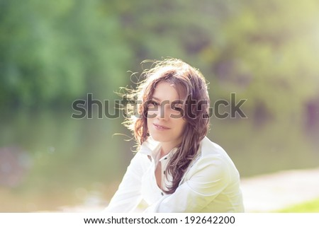 Summer Girl Portrait. Caucasian Brunette Woman Smiling Happily on Sunny Day Outdoors in Park. Horizontal Image - stock photo