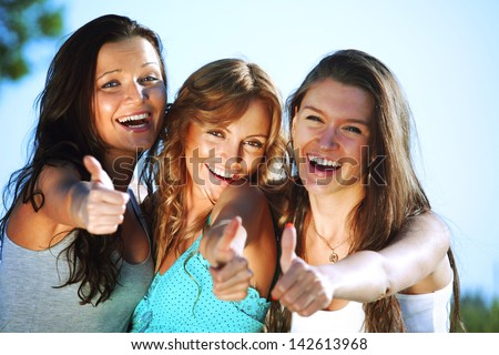 summer girlfriends in sun ligt happy and smile - stock photo