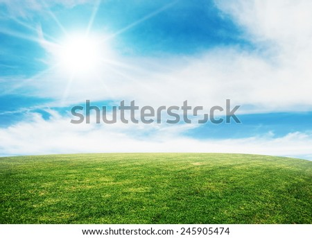 summer grass lawn with sky and sun - stock photo