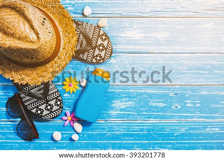 Summer holiday background, Beach accessories on blue distressed wood table, Vacation and travel items - stock photo
