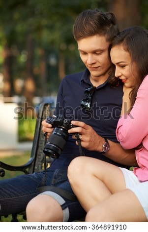 Summer holiday concept: couple watching photos of their walk on the digital tablet