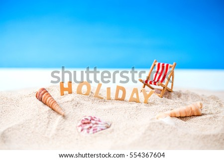 Summer holiday decoration with holiday wooden text, beach chair and sea shall on white sand beach with tropical blue sea and clear blue sky,Image For Love summer holiday vacation travel Concept.