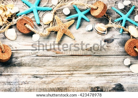 Summer holiday frame with seashells and fishing net. Copy space  - stock photo