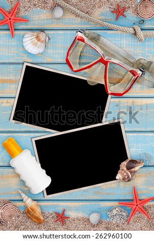 Summer holiday items on blue wooden surface