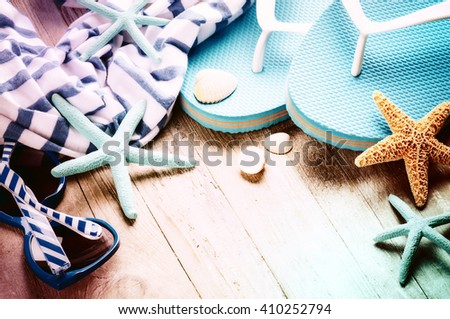 Summer holiday setting with flip flops and beach wear. Copy space - stock photo