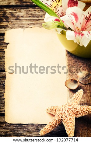 Summer holiday setting with seashells and tropical flowers  - stock photo