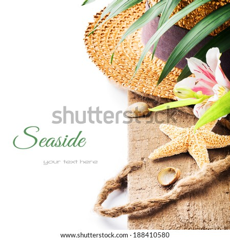 Summer holiday setting with straw hat  - stock photo