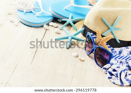 Summer holiday setting with straw hat and flip flops. Copy space - stock photo