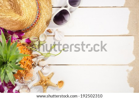 Summer holiday setting with straw hat, pineapple and sunglasses - stock photo