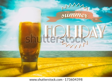 Summer holiday sign with beer glass on beach - stock photo