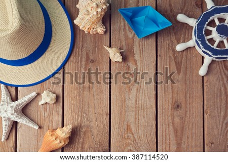 Summer holiday travel background with seashells and paper boat. View from above. Flat lay - stock photo